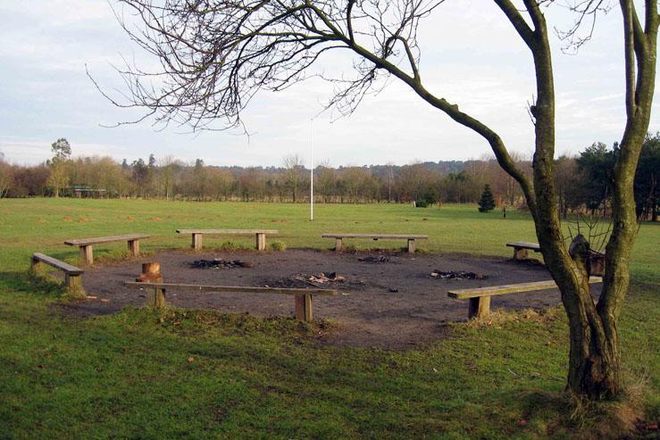 3 Campfire Circle with camping field behind behind